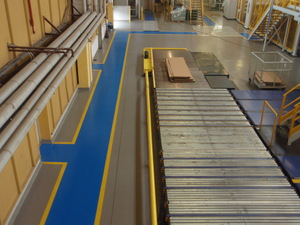 Quarzcolor Mono floor with separated traffic lanes in a paper production industry.